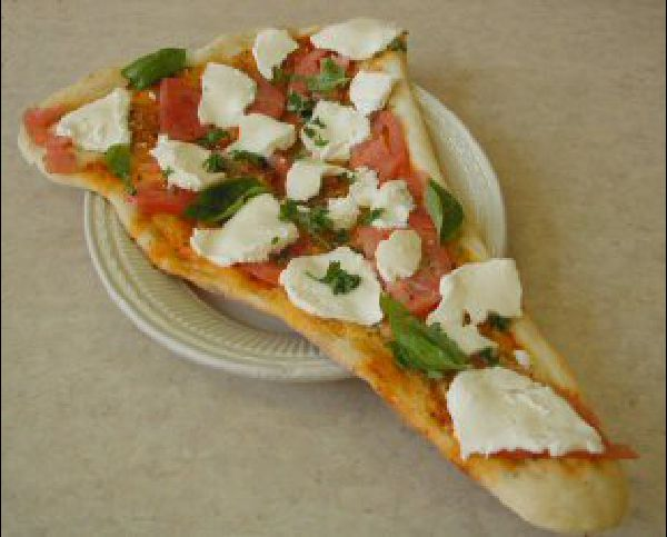 Pizza Rustica with fresh basil and mozzarella cheese from Francesca's Pizzeria and Restaurant in Great Neck, NY
